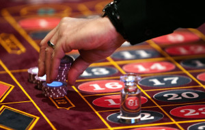 A dealer moves chips at a roulette table during the first day of table games at Hollywood Casino at Penn National Race Course in East Hanover Township, Pa. Tuesday, July 13, 2010. (AP Photo/The Patriot-News, Dan Gleiter)